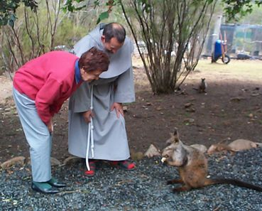 Visitor with Br Howard admiring a rock wallaby